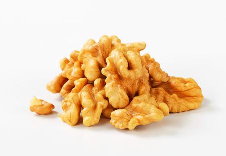 halved  half: Heap of fresh shelled walnuts