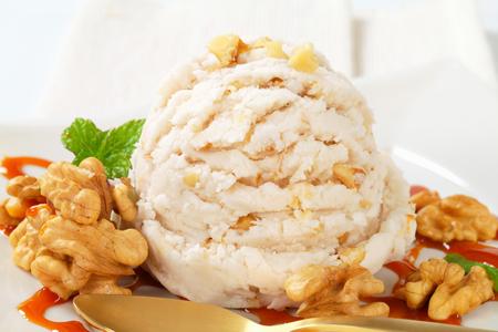 caramel sauce: Scoop of walnut ice cream with caramel sauce Stock Photo