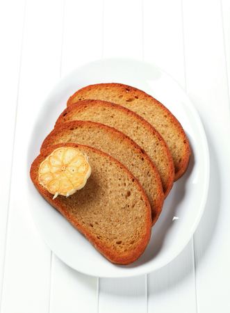 accompaniment: Pan fried continental bread with garlic Stock Photo