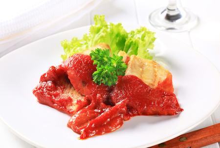 haddock: White fish fillets in rich tomato sauce