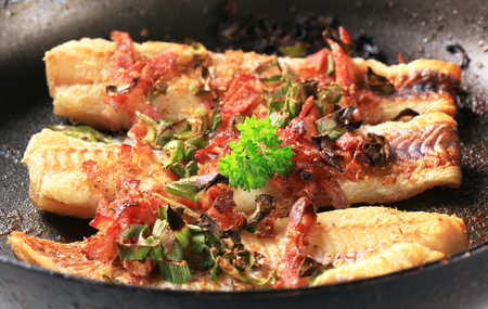 haddock: Pan fried fish fillets with bacon and spring onion