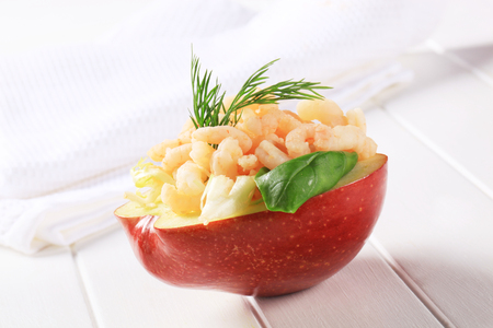 half apple: Half apple topped with shrimps Stock Photo