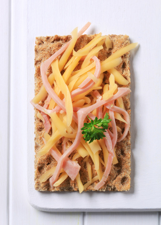 crispbread: Crispbread with strips of ham and cheese Stock Photo
