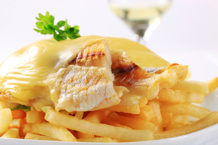 coalfish: Cheese topped fish fillets served with French fries