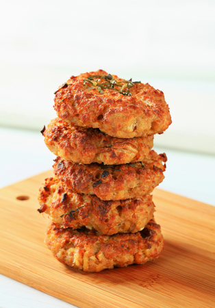 Fried vegetable burgers on cutting board