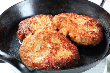 skillet: Pan fried vegetable burgers in a skillet