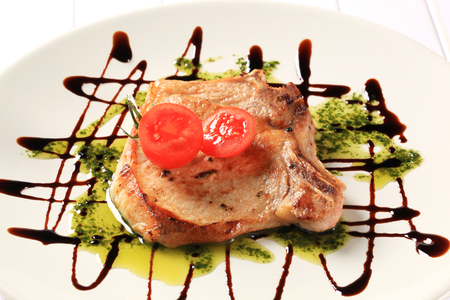 drizzle: Pan-roasted pork chop with pesto and balsamic drizzle