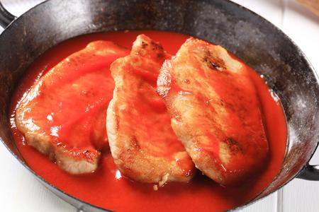 pork chops: Pork chops in tomato sauce Stock Photo