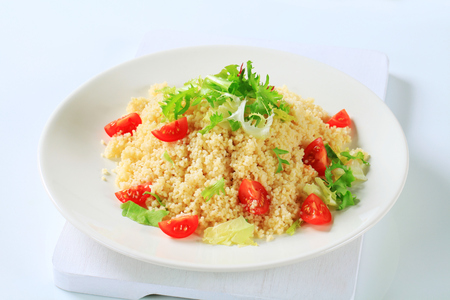 salad greens: Couscous with salad greens and cherry tomatoes