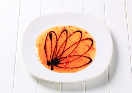 balsamic: Hot sauce and balsamic vinegar on plate