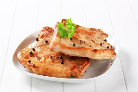 Pan seared pork chops with black peppercorns