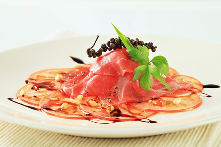 balsamic vinegar: Tomato and beef Carpaccio with  balsamic vinegar Stock Photo
