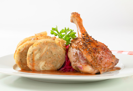 Dish of roast duck leg with bread dumplings and red cabbage photo