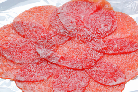 thinly: Thinly sliced raw beef tenderloin