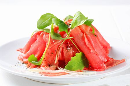 salad greens: Beef Carpaccio with salad greens
