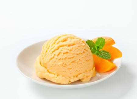 yogurt ice cream: Scoop of apricot ice cream Stock Photo