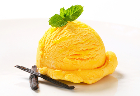 custard flavor: Scoop of yellow ice cream on white background Stock Photo
