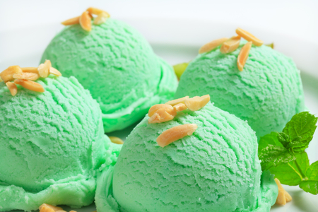 scoops: Scoops of light green ice cream