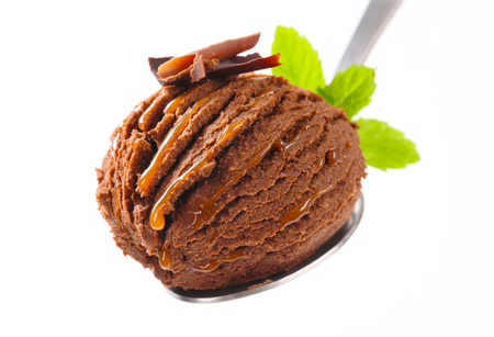 fudge: Scoop of chocolate fudge ice cream on spoon