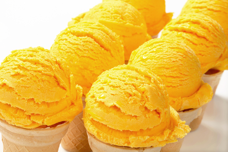 custard flavor: Scoops of yellow ice cream in wafer cones Stock Photo