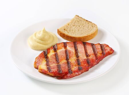 dollop: Grilled pork neck meat with bread and mustard sauce