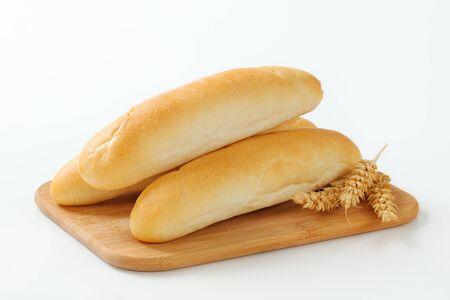 long shots: White bread rolls on cutting board