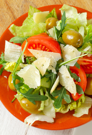 roquette: Fresh vegetable salad with green olives and Parmesan