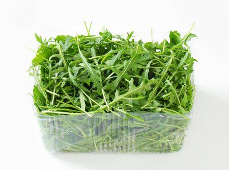 plastic container: Arugula leaves in plastic container