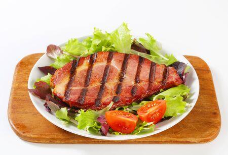 salad greens: Grilled pork neck meat with salad greens