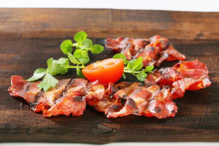 dark brown: Grilled thin sliced pork on dark brown wood