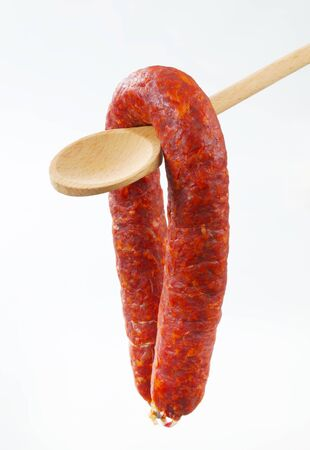 dry sausage: Spicy dry sausage on wooden spoon
