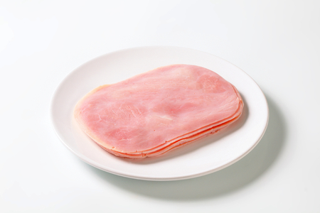 thinly: Thinly sliced ham on plate