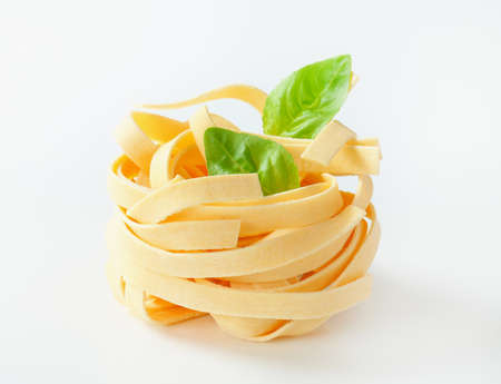 bundle: Bundle of dried ribbon pasta Stock Photo