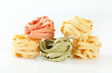 bundles: Bundles of dried ribbon pasta