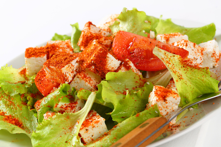 diced: Diced feta cheese with fresh lettuce and tomatoes Stock Photo