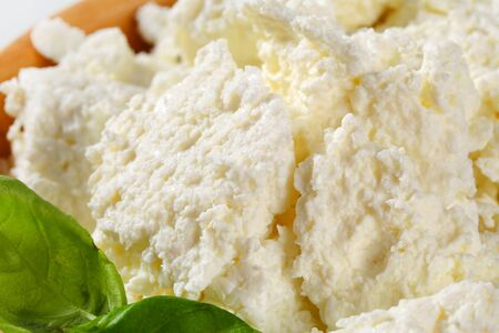 crumbly: Bowl of white crumbly cheese
