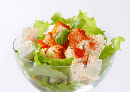 diced: Diced feta cheese with fresh vegetable salad Stock Photo