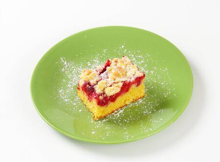 crumb: Piece of raspberry crumb cake