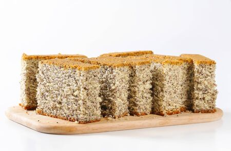 quick snack: Slices of poppy seed cake on cutting board Stock Photo