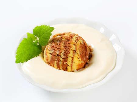 vanilla pudding: Vanilla pudding and scoop of ice cream Stock Photo