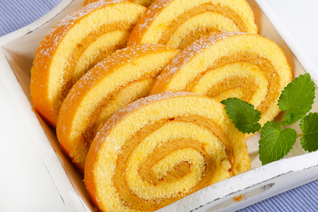 swiss roll: Slices of Swiss roll cake filled with coffee mousse cream Stock Photo