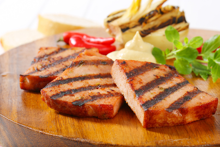 meatloaf: Grilled slices of meatloaf with mustard