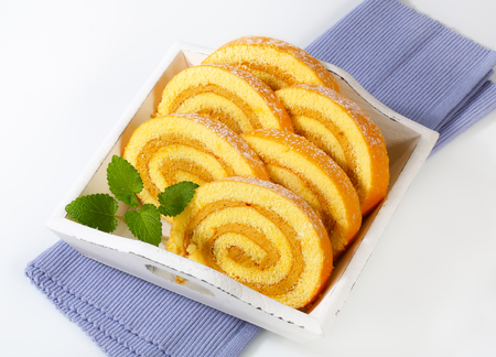 swiss roll: Slices of Swiss roll cake with mocha almond filling Stock Photo