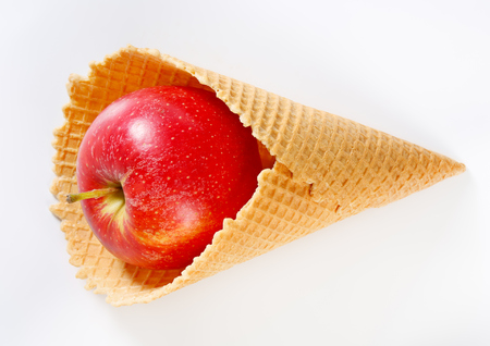cornet: Fresh red apple in waffle cornet Stock Photo