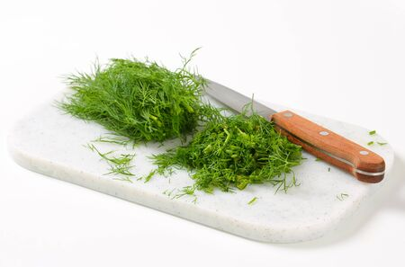 sprigs: Sprigs of fresh dill weed on cutting board