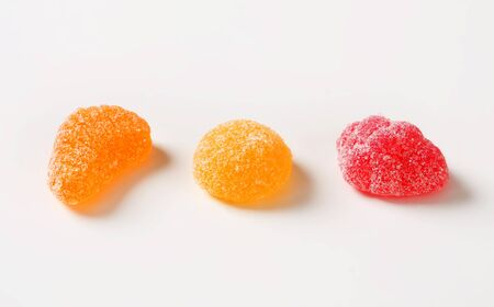 granulated: Fruit-shaped gummy candy coated in granulated sugar Stock Photo