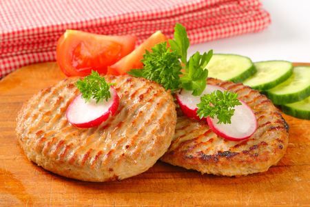 pan fried: Pan fried patties with sliced vegetables Stock Photo