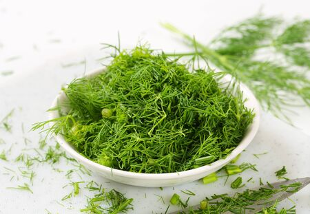 dill leaves: Bowl of fresh chopped dill leaves Stock Photo