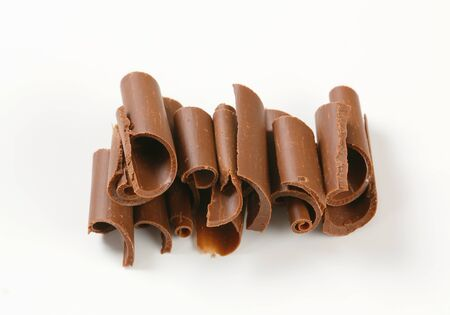 curls: Chocolate curls on white background