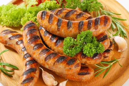 cutting: Grilled bratwursts on cutting board